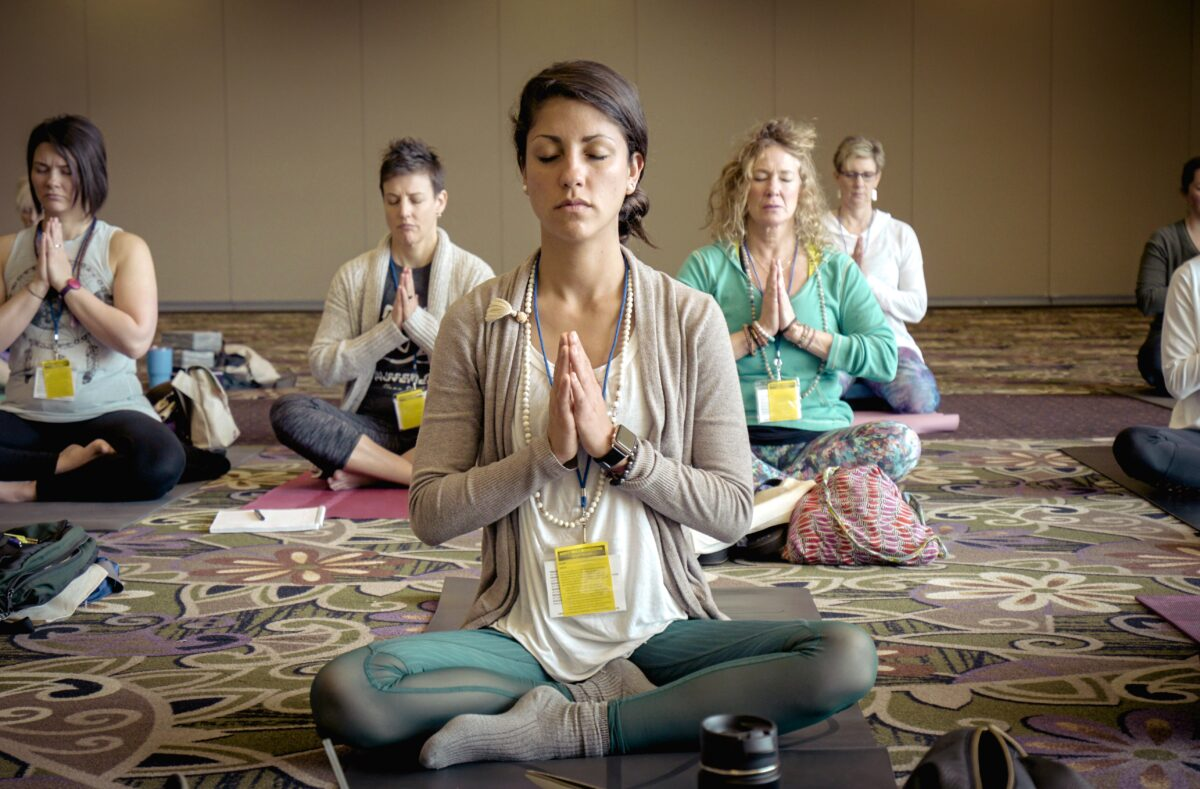 people meditating together in a room