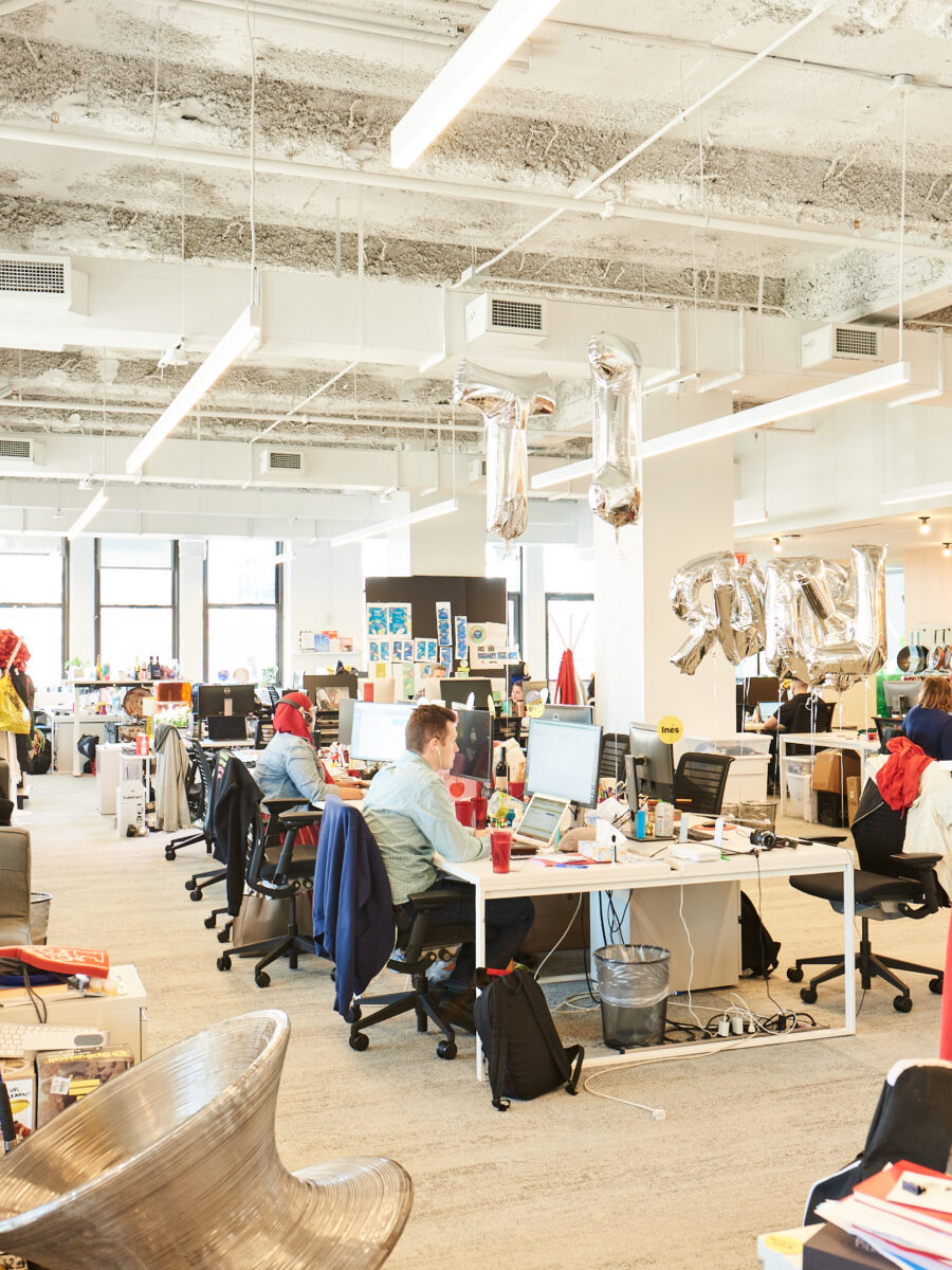 buzzfeed new york office colorful open plan office with balloons
